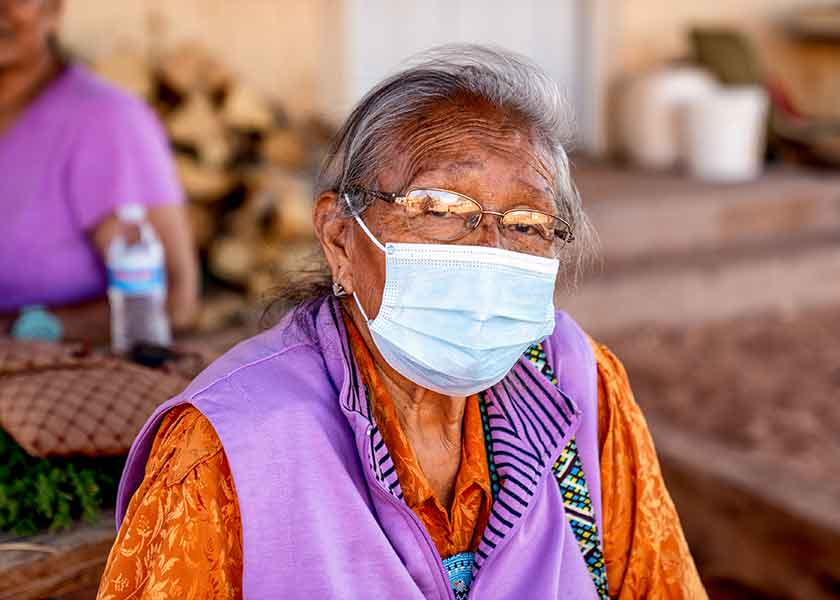 Older Navajo woman wearing a mask to avoid COVID