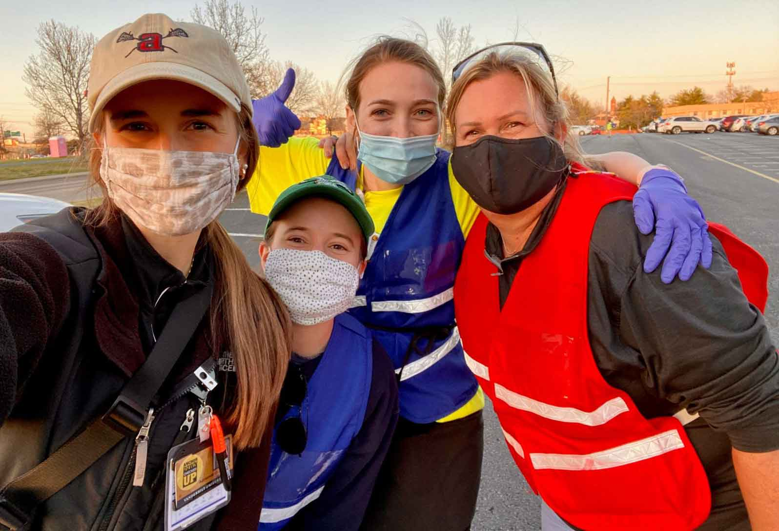 Vanderbilt students and faculty in masks and safety vests