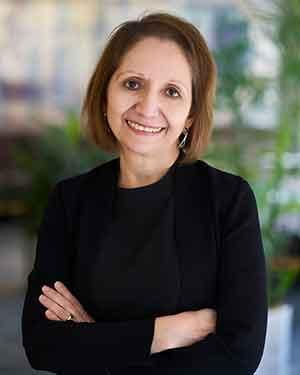 Antonia Villarruel standing in front of greenery