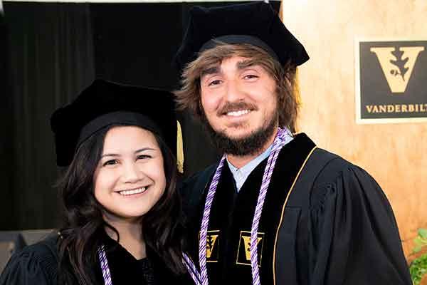 DNP graduates Emily Brignola and Josh Waddell in front of the VU podium