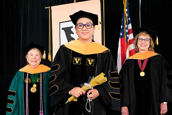 Dean Norman, Monaliza Gaw, Terri Allison stand on stage