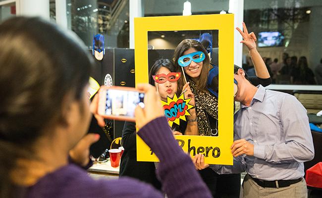 Vanderbilt MBA students enjoying new products and marketing ideas students have made at Marketing Madness.