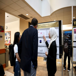 student presenting at their poster
