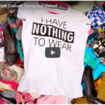 "On a pile of colorful clothes in disarray, a white t-shirt with black text reads ""I HAVE NOTHING TO WEAR."""
