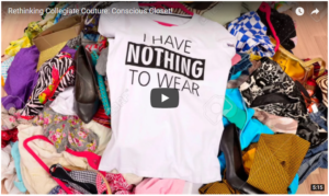 """On a pile of colorful clothes in disarray, a white t-shirt with black text reads """"I HAVE NOTHING TO WEAR."""""""