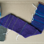 purple scarf with intervals of white yarn