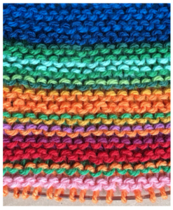 knitting running from blue to green to orange to red to pink