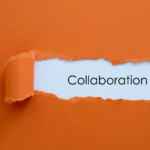 Orange paper with the word collaboration