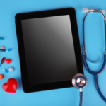 iPad with stethoscope on blue background