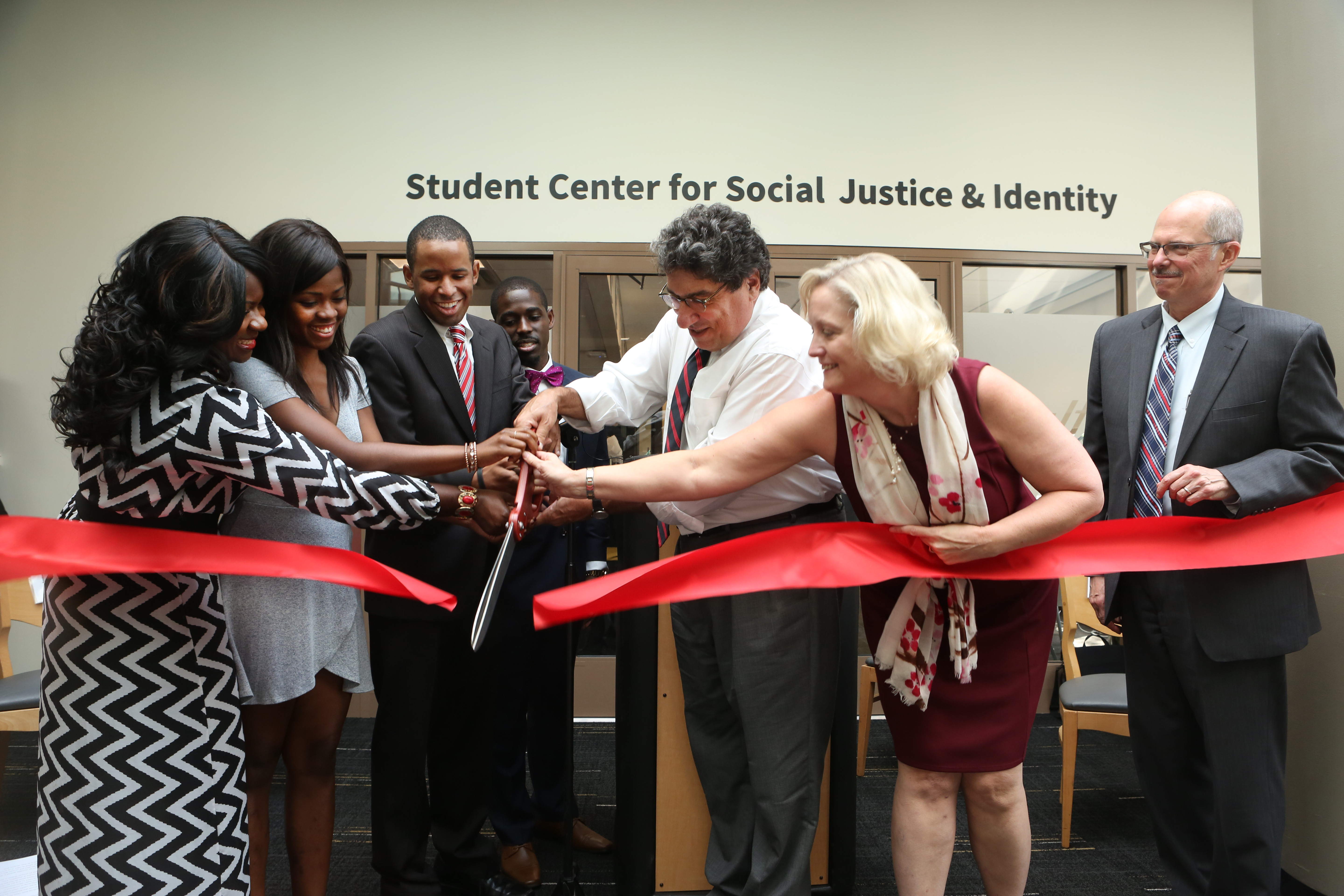 Ribbon cutting at the Grand Opening of the Student Center for Social Justice & Identity.