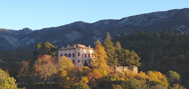 Picasso's Château on a hill surrounded by fall foliage, Vauvenargues, France