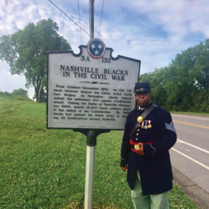"Gary Burke in USCT uniform with ""Nashville Blacks in the Civil War"" placard outside Fort Negley, no date"