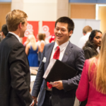A student at a Career Fair speaking to an employer