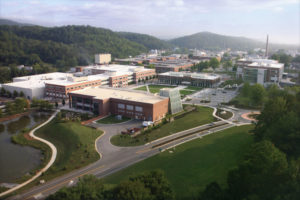 Aerial view of the Oak Ridge National Laboratory: several brick buildings in a mountainous setting