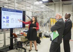 Dr. Hiba Baroud presenting research to two visitors from the Army Research Laboratory