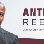 Anthony Reed: text: Associate professor of English