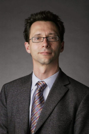 photo of Jonathan Gilligan against a gray background