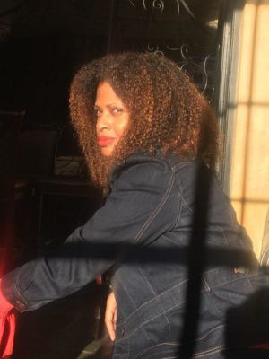 photo of Tracy Sharpley-Whiting sitting in an outdoor cafe