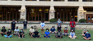Gilman Whiting and students from his capoeira class pose, masked and socially distanced, on lawn in front of Wilson Hall
