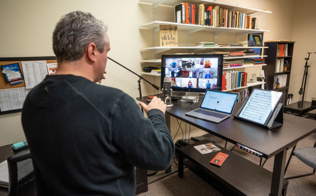 Tucker Biddlecombe, associate professor of choral studies, teaches his choral class online with his students in his office at Blair School of Music. (Vanderbilt)