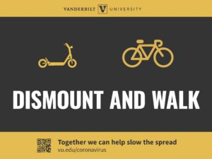 Dismount and walk your bike signage