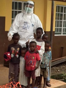 Crozier, dressed in personal protective equipment, with Ebola-positive Sierra Leonean children. Schools remain closed in Sierra Leone and Liberia, two countries hit hard by the Ebola outbreak. Photo by WHO/K. Hurley.