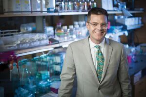A single person infected with HIV carries more variations of the virus than all the influenza strains isolated worldwide, says James Crowe Jr., M.D. Photo by John Russell.