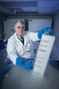 John Phillips, M.D., with Vanderbilt's cryogenic storage system that contains not only cells, but clues to rare diseases. Photo by John Russell.