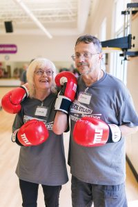 Linda Jones and Steve Retterer fight Parkinson's disease by taking boxing classes at their local YMCA. Photo by Daniel Dubois.