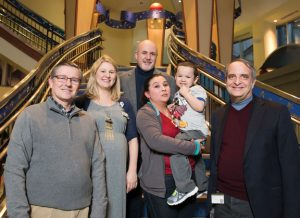 Maribel Giron, center, holds  her son, Denny Majano, with members of the Monroe Carell Jr. Children's Hospital team who cared for him. From left are, Hernan Correa, M.D., Kelly Thomsen, M.D., MSCI, Sari Acra, M.D., MPH, and James Goldenring, M.D., Ph.D. Photo by Joe Howell.