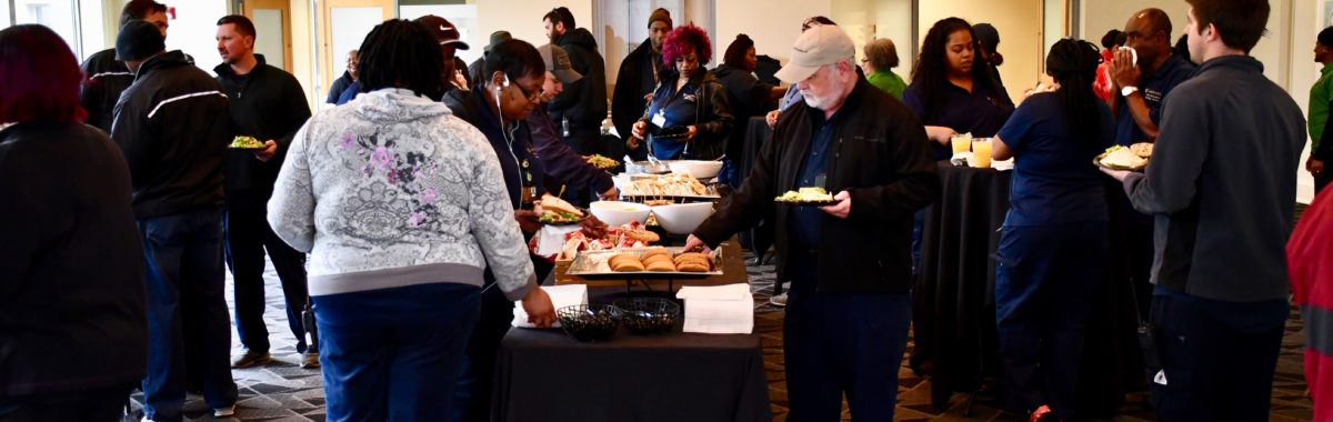 Members of Vanderbilt's Plant Operations and Public Safety departments enjoying lunch.